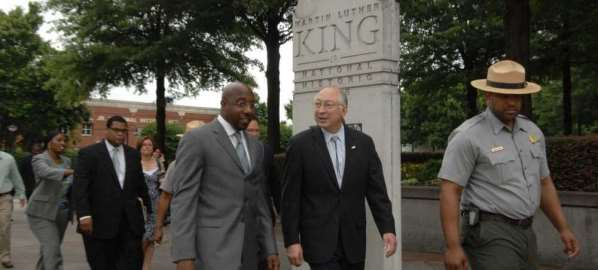 Reverend Raphael Warnock and Ken Salazar at the Martin Luther King memorial.
