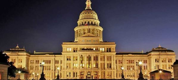 Texas State Capitol in Austin, TX at night.